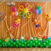 Украшение зала на выпускной в детском саду во Владимире — солнышко, полянка, фигурки мальчика и девочки